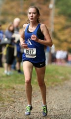 Mackenzie Hughes of Academy of the Holy Angels, led the United Division race from start to finish.  She finished with a time of 18:26, nearly a full minute faster than her closest competitor at Darlington County Park in Mahwah, Friday, October 13, 2017.