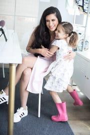 Monica Royer, founder of Monica + Andy children's clothing, with her daughter.