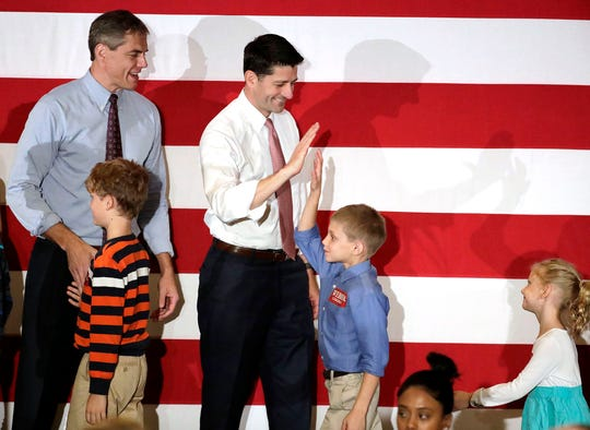 U.S. House Speaker Paul Ryan, center, greets children of Jay Webber, top left, Republican candidate for Congress in the 11th District of New Jersey, during a campaign event, Wednesday, Oct. 17, 2018, in Hanover, N.J. (AP Photo/Julio Cortez)