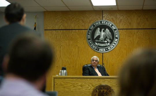Thomas Griego, executive director of the Public Employee Labor Relations Board, listens to Jeffrey Toppel, an attorney representing the Doña Ana County District Attorney's office in a prohibited practices hearing, Tuesday October 16, 2018.