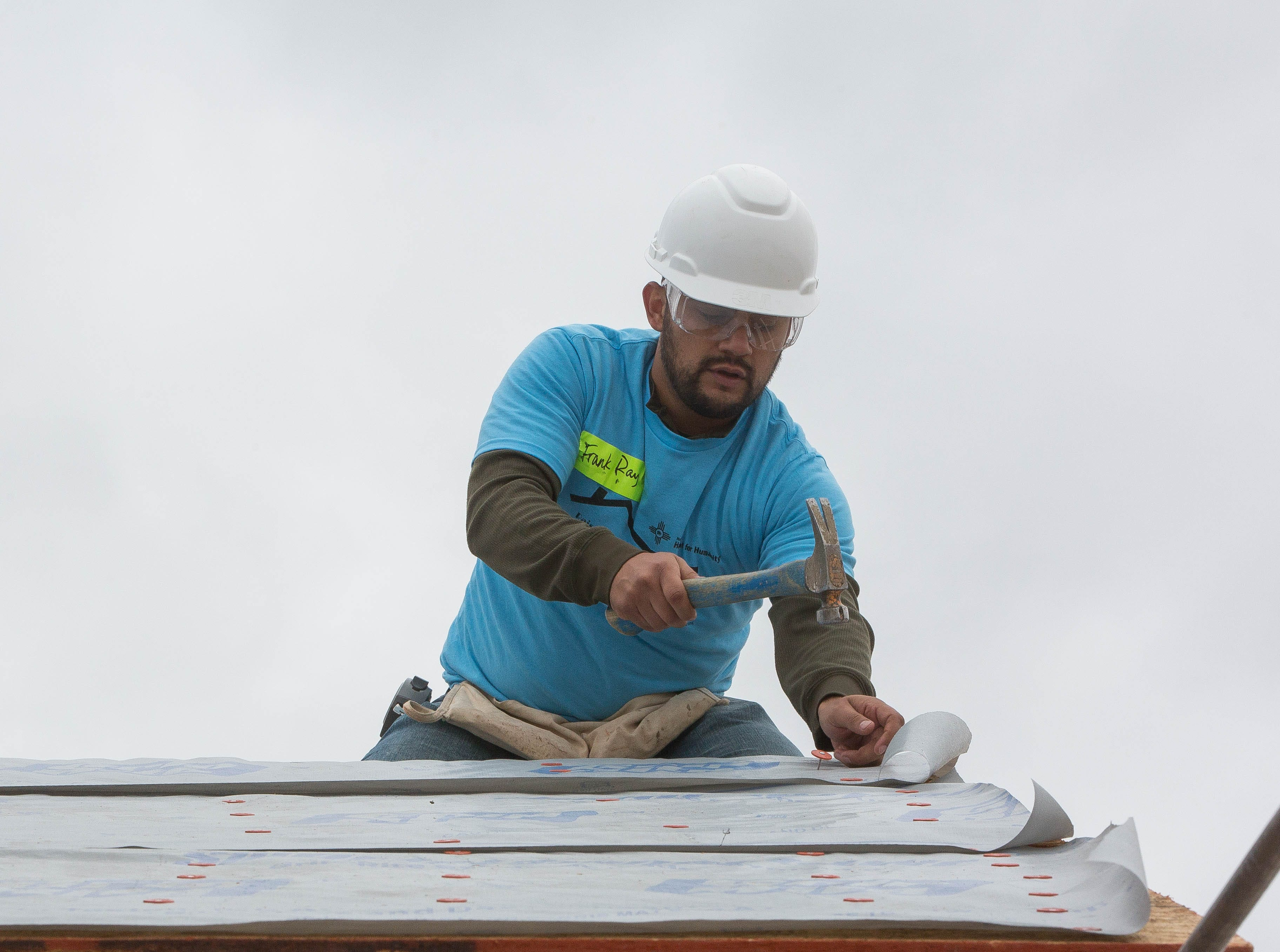 Frank Ray, the country musician, working on the roof of one of the Habitat for Humanity Homes on Aurora Star Court, Wednesday October 17, 2018.