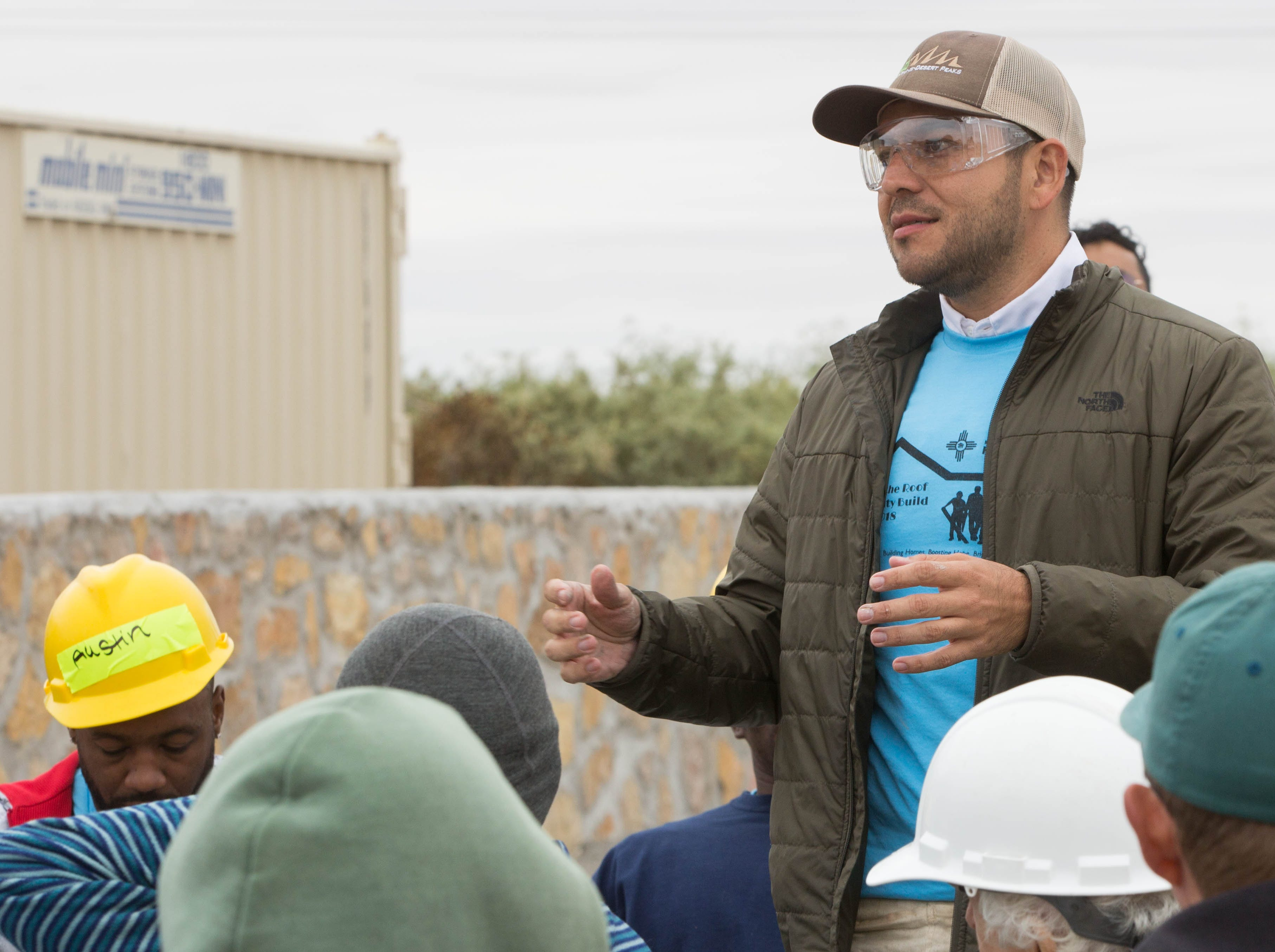 Gabe Vasquez, district 3 city councilor, along with a few other local celebrities that joined other volunteers at the Habitat for Humanity build site on Aurora Star Court, Wednesday October 17, 2018.