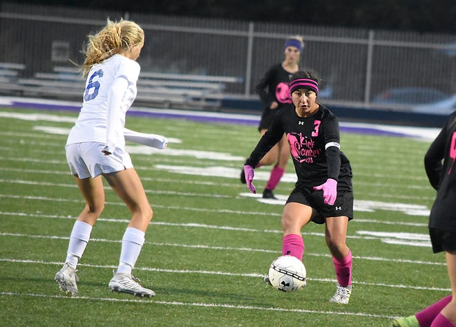 Carlsbad midfielder Jessica Munro (6) challanges Clovis' Sofia Rico (3) in the first half of Tuesday's game.