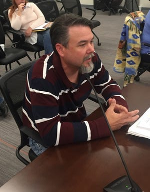 Ty Allen of the Bureau of Land Management's Carlsbad Field Office explains the Resource Management Plan to the Eddy County Board of Commissioners Oct. 16.