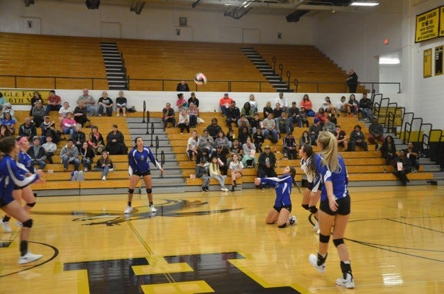 The Cavegirls try to save a ball during Tuesday's match against Hobbs. Hobbs won in five sets.