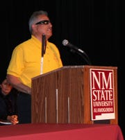National Federation of the Blind-White Sands Chapter member Barry Lorenzo speaks during the National White Cane Safety Day Festivities at NMSU-A Tuesday.