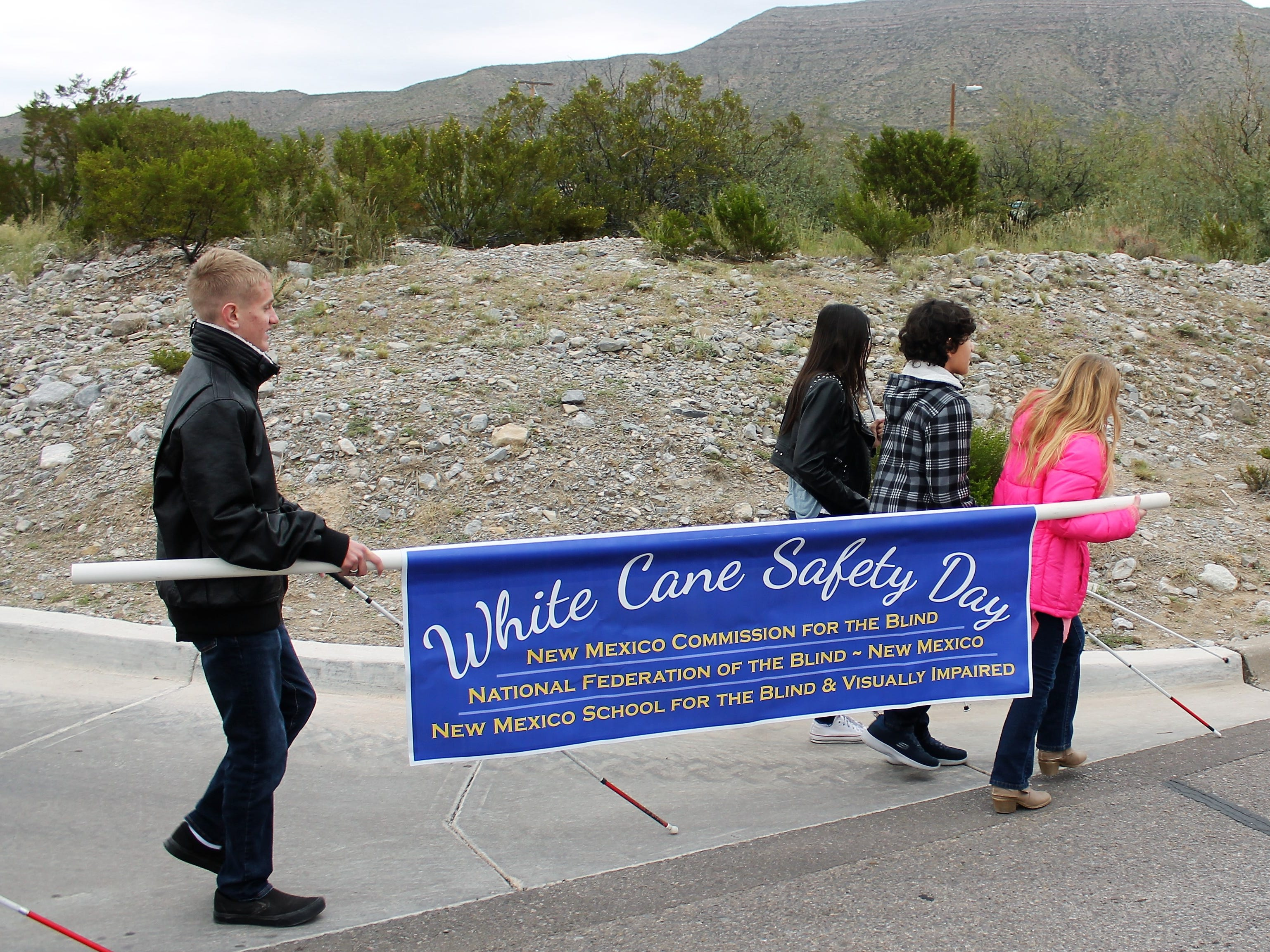 Tuesday marked the annual White Cane Safety Day which began with the White Cane Walk from the Wal-Mart Neighborhood Market on Indian Wells to the Rehovec Theatre on the New Mexico State University-Alamogordo campus.
