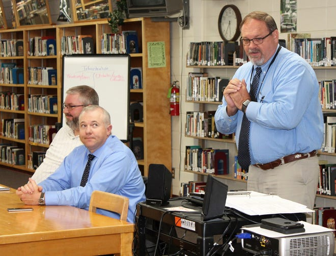APS Chief of Staff Doyle Syling, right, speaks during a public forum Tuesday as Steve van Duyn, center, and Justin Burks, right, listen. The APS Educational Technology Committee set up forums for staff and public to discuss how to implement new education technology.
