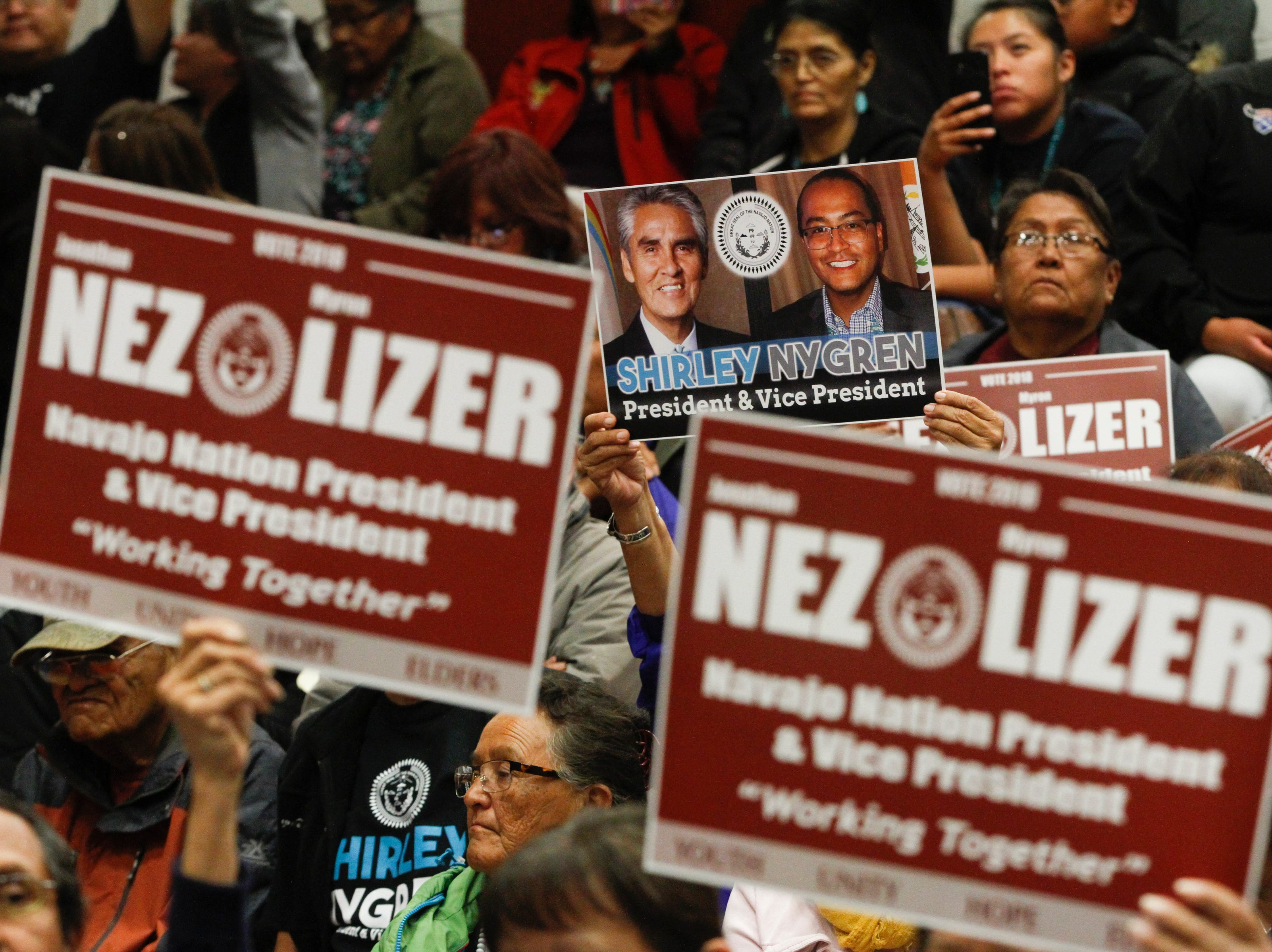Supporters cheer for their candidates, Tuesday, Oct. 16, 2018 during a presidential candidate debate at Navajo Technical University's Wellness Center in Crownpoint.