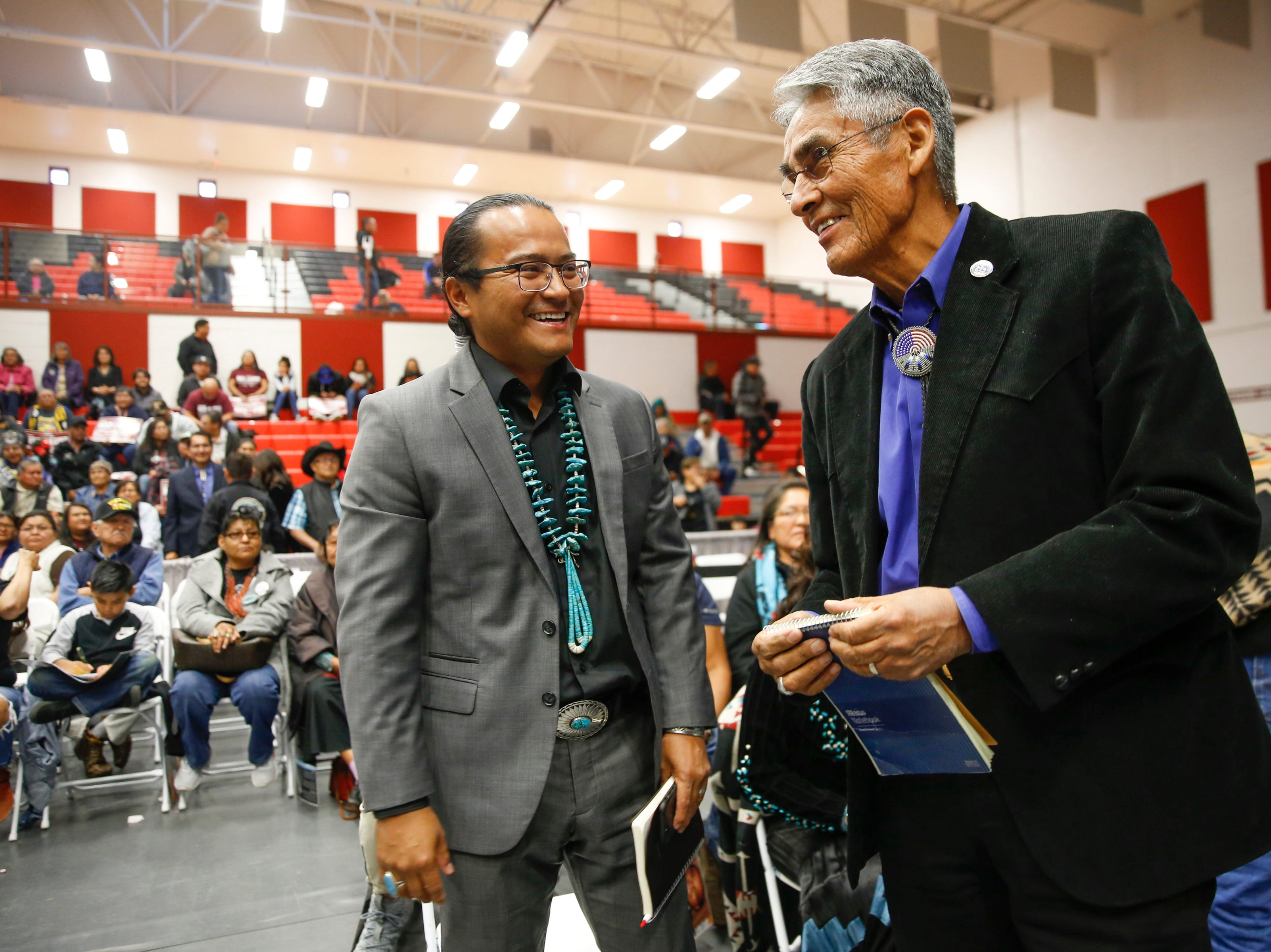 Buu Nygren, left talks with Joe Shirley Jr., before the start of Shirley's debate against Jonathan Nez, Tuesday, Oct. 16, 2018 at Navajo Technical University's  Wellness Center in Crownpoint.