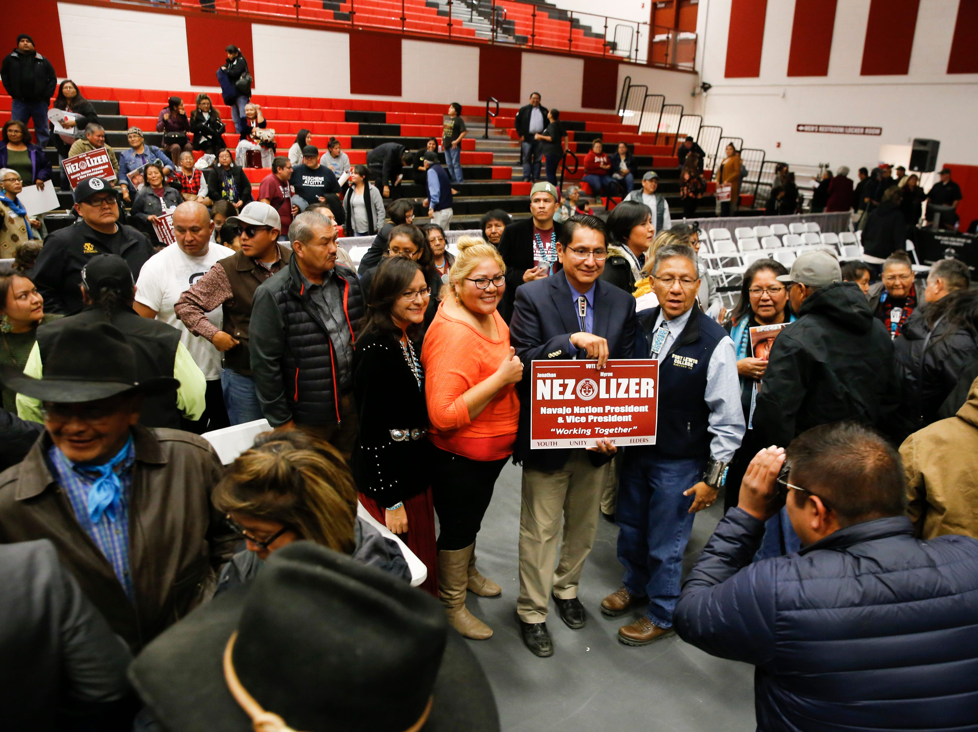 Navajo Nation Presidential candidate Jonathan Nez, at center, and his running mate Myron Lizer, at right, pose for photos at the conclusion of the 2018 Presidential Debate, Tuesday, Oct. 16, 2018 at Navajo Technical University's  Wellness Center in Crownpoint.