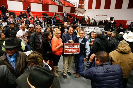 Navajo Nation presidential candidate Jonathan Nez, center, and his running mate, Myron Lizer, right, pose for photos at the conclusion of a debate Tuesday at Navajo Technical University's Wellness Center in Crownpoint.
