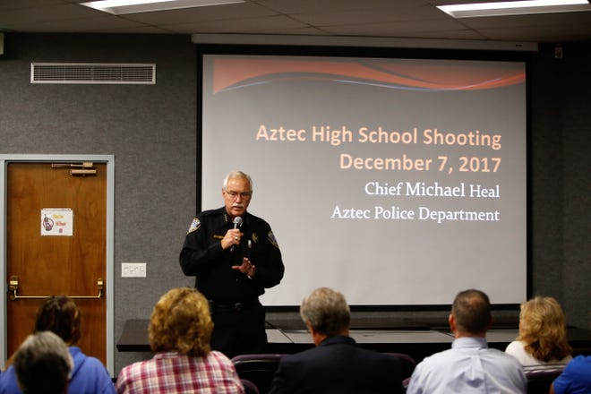 Aztec police Chief Mike Heal gives a presentation about the Aztec High School shooting Tuesday in the commission room at Aztec City Hall.