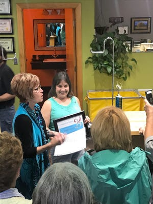 Tammi Waterfield receives Champion of Service award presented to her by the Ruidoso Valley Greeters and Chamber of Commerce.