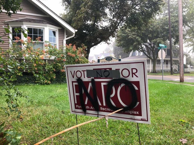 Pictured is one of the vandalized Vote Yes For PARC signs in downtown Plymouth.