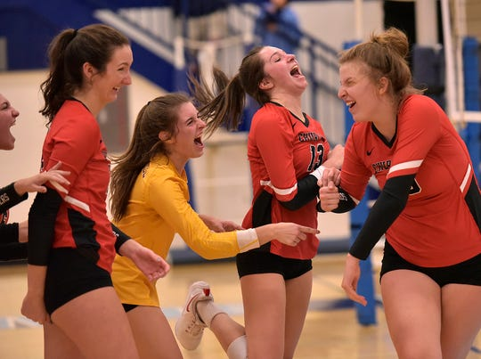 Chargers Mary Claire Yost, Jessica Maledecki, Sarah Dunn, and Summer Clark celebrate winning the first set, 25-18.