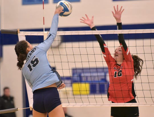 Spartan Koryn Parmenter hits the ball on defender Mary Claire Yost.