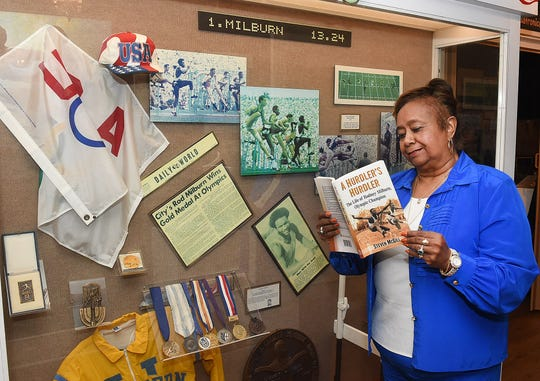 Lena Charles visits the Rod Milburn exhibit on display at the Opelousas Museum and Interpretive Center.