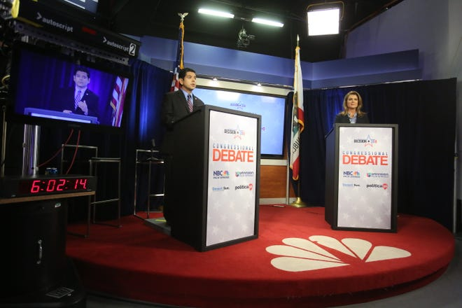 Congressional candidates Raul Ruiz and Kimberlin Brown Pelzer on stage at the NBC Palm Springs-Desert Sun debate.