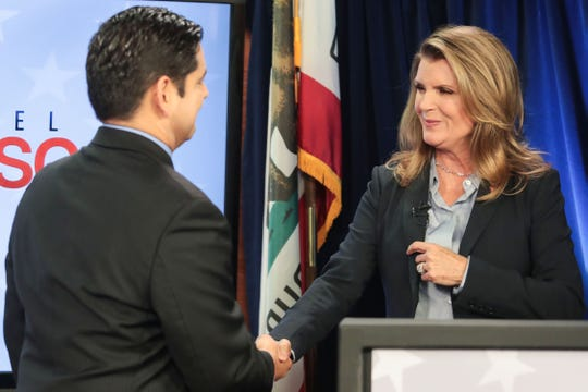 Democratic US Congressman for the 36th District Raul Ruiz M.D. and his Republican challenger Kimberlin Brown Pelzer shake hands after their televise congressional debate on Tuesday, October 16, 2018 at NBC Palm Springs.