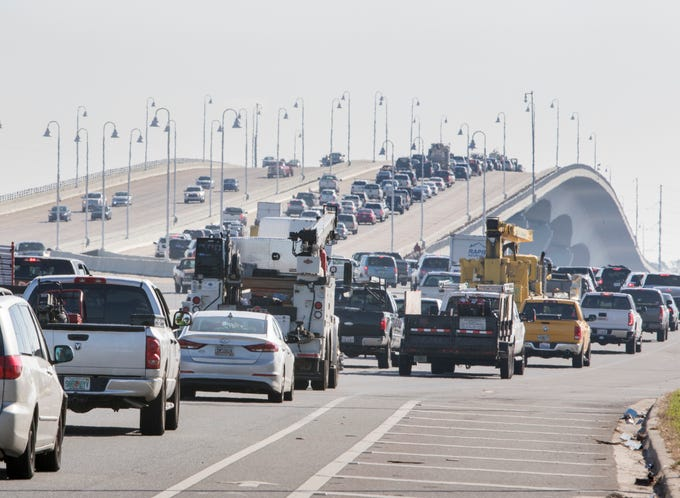 Bumper to bumper traffic crawls across the Hathaway Bridge on Highway 98 into Panama City, Florida on Wednesday, October 17, 2018.  Traffic in and out of the city has been getting worse each day since Hurricane Michael blew through the area as more people return and more services arrrive.