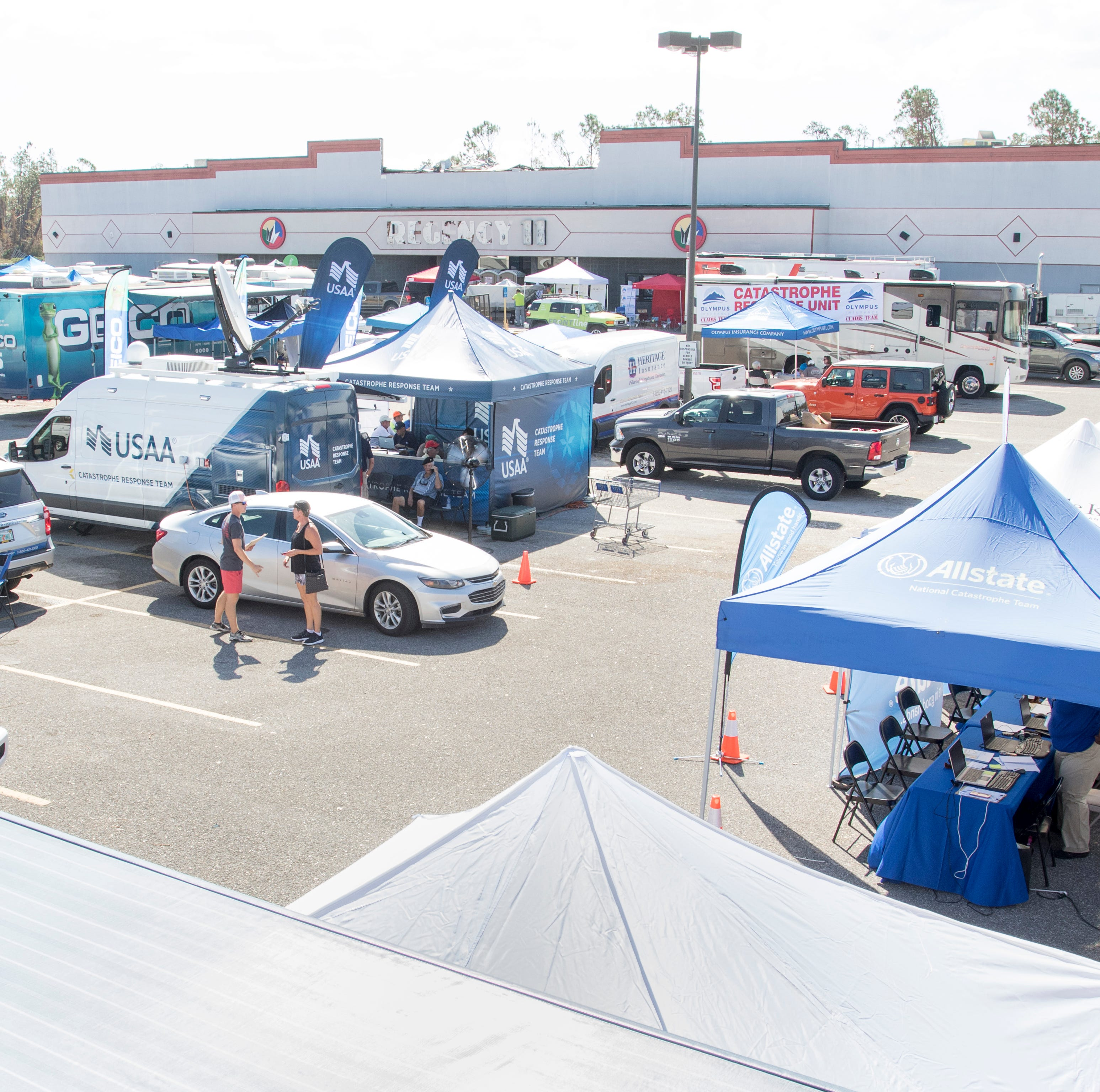 An insurance village as been set up on West 23rd Street to service clients affected by Hurricane Michael in Panama City, Florida on Wednesday, October 17, 2018.