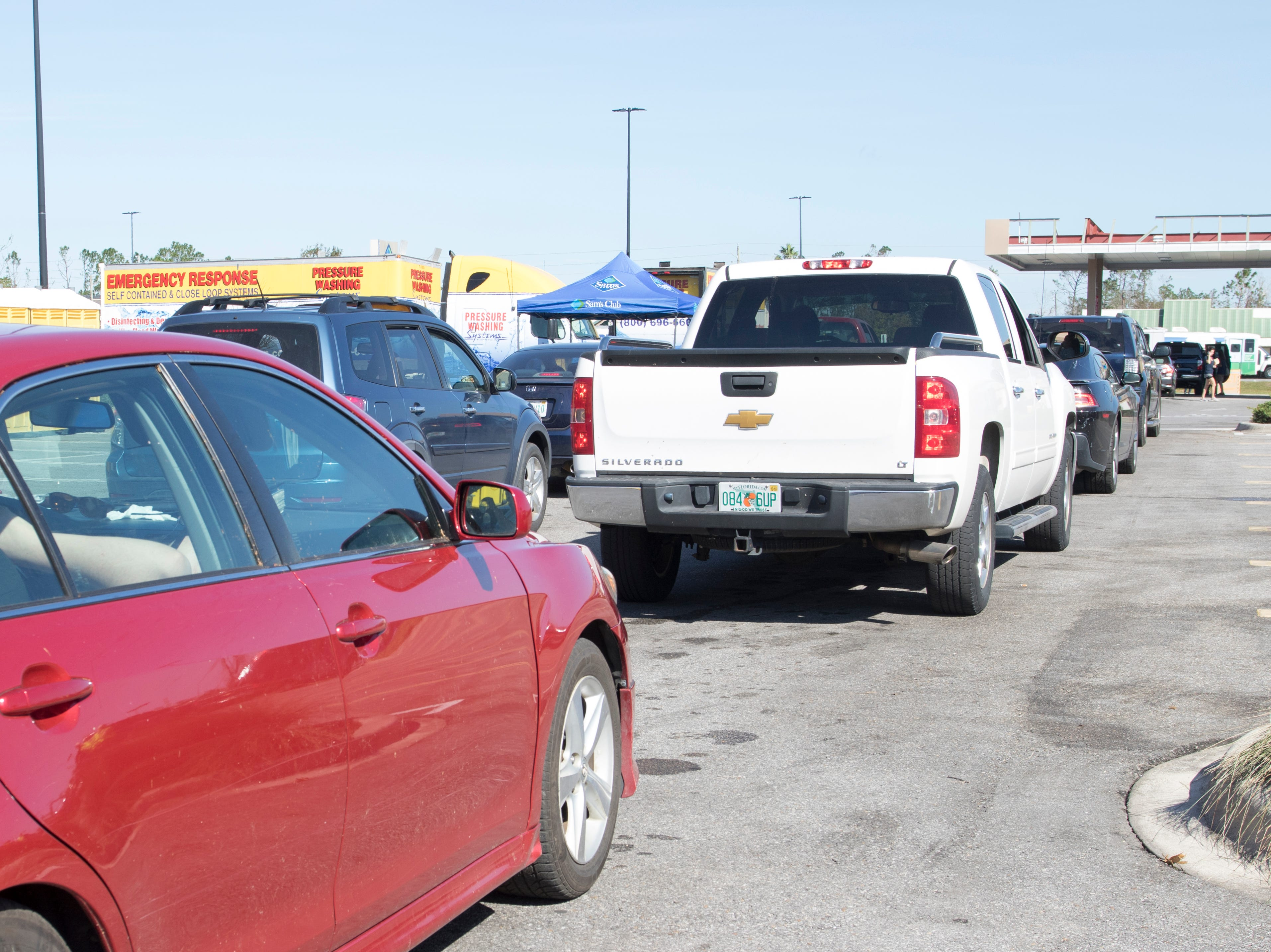 A long line of vehicles wait for gas at the Sam's Club on West 23rd Street in Panama City, Florida on Wednesday, October 17, 2018.  Drivers are thrilled that their wait for gas has gone from up to 4 hours earlier in the week down to 30 to 45 minutes today.