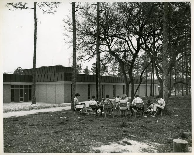 Woodham High School's first classes sometimes met outside — and ate outside — as the school was being completed.
