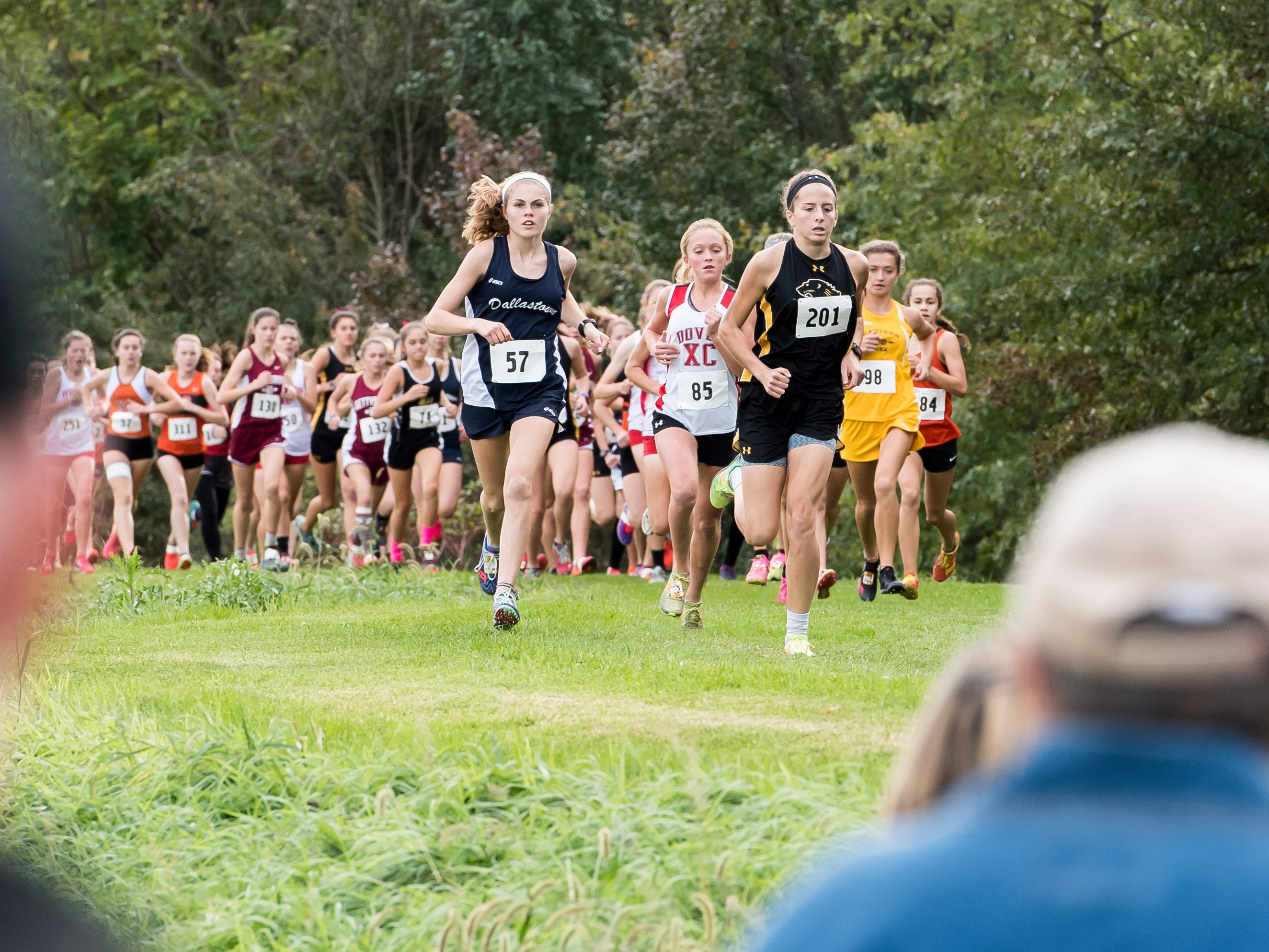 Red Lion's Kiersten Lloyd, right, and Dallastown's Emily Schuler lead the pack during the YAIAA cross country championship at Gettysburg Area High School on Tuesday, October 16, 2018. Lloyd and Schuler finished second and first, respectively.
