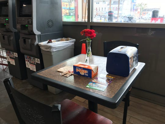 Royal Farms staff set up James Dell's usual table with flowers and his usual purchases in his memory.
