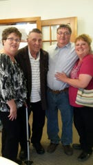 James Dell stands with his three children. From left to right: Robin Pittinger, James Dell, Randy Dell and Pennie Gilbert.