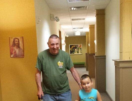 James Dell and his great grandson walk with matching canes. As the story goes, his great grandson would take James' cane,  so James bought him one of his own.