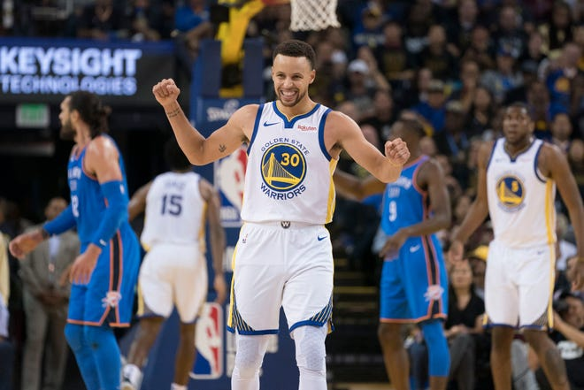 Golden State Warriors guard Stephen Curry (30) reacts during a game against the Oklahoma City Thunder on Oct. 16.