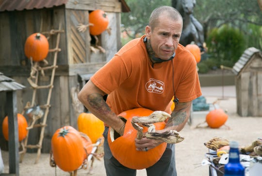 Ray Villafane, a world-renowned pumpkin carver, works on setting up a scene at Carfree's Enchanted Pumpkin Garden. The garden opens October 19 and runs through October 28.