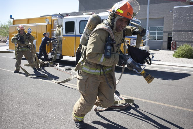 Eric Fields with the Glendale Fire Department pulls hose during a training drill at the Glendale Regional Public Safety Training Center, 11550 W. Glendale Ave., in June 2011.