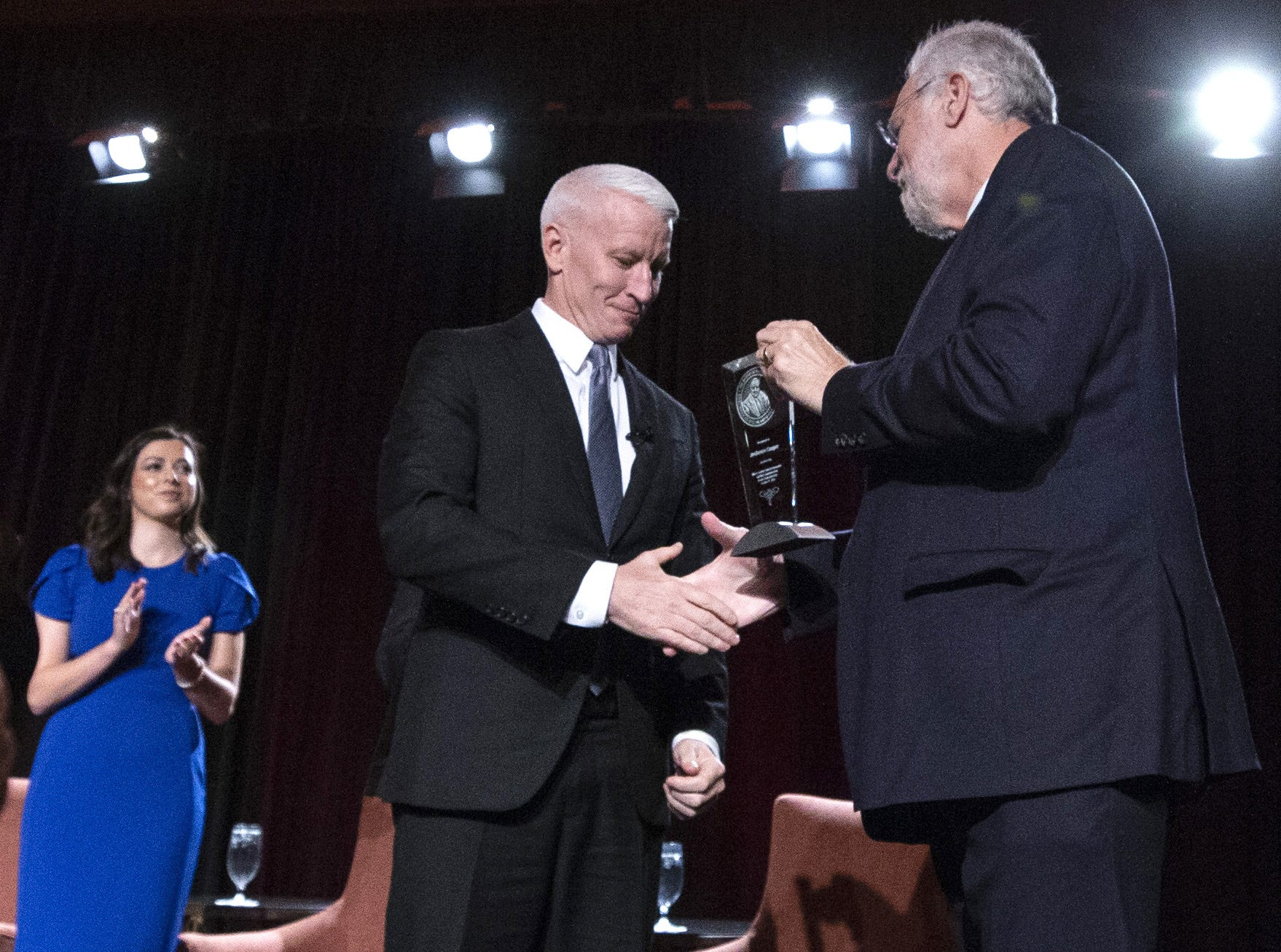 Arizona State University executive Vice President and University Provost Dr. Mark Searle, right, presents CNN anchor Anderson Cooper with the annual Cronkite award for excellence in journalism during a luncheon at the Sheraton in Phoenix on October 17, 2018.