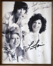 """An autographed photo from the TV show """"Alice"""" hangs on the wall at Mel's Diner in Phoenix in 2010.  The eatery was the setting for the 1970s CBS television show """"Alice."""""""