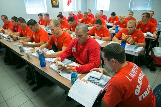 Firefighter recruits attend a hazardous-materials response class at Glendale Regional Public Safety Training Center in August 2014.