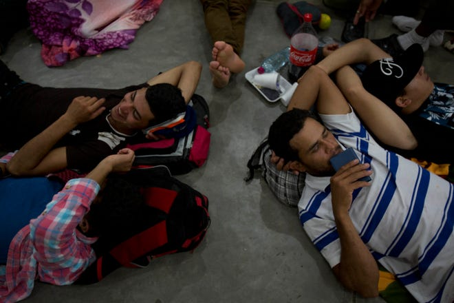 Honduran migrants rest Tuesday, Oct. 16, 2018, at an improvised shelter in Chiquimula, Guatemala.