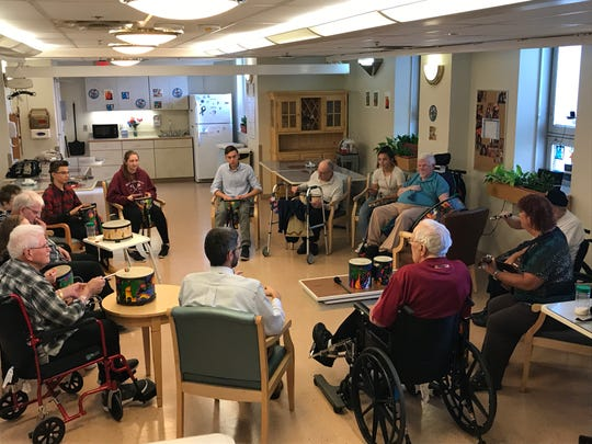 "Cedar Crest students and veterans join in a drum circle as part of the ""Battle Buddies"" program at the Lebanon VA Medical Center on Oct. 17, 2018."
