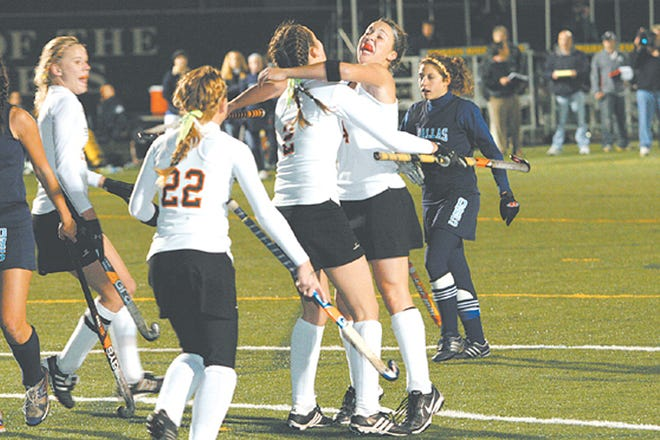 Palmyra's Kristen Foore (2)and Jenn Sciulli (34) celebrate Sciulli's goal in the state semifinals in 2007, as Jill Keefer, left, and Lindsay Bowman (22), rush in to join the celebration. It has been 11 years since the Palmyra field hockey team's stirring run to the state finals following the tragic death of teammate Cassie Altfather.