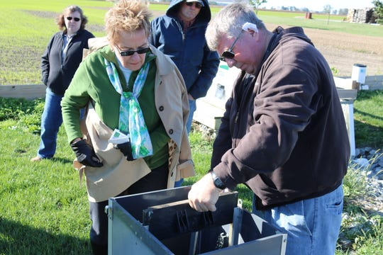 Duane Stateler, of Stateler Family Farm, part of the Blanchard River Demonstration Farms Network, shows U.S. Rep. Marcy Kaptur, D-Toledo, how these gates control water drainage from his fields.