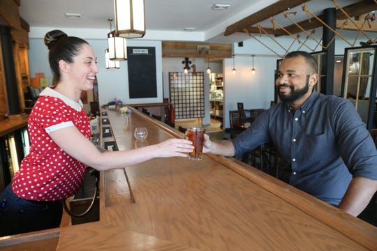 Bartender Renee Purdy serves front of house manager Kellan MacKenzie at Dutchess BBQ in the Town of Poughkeepsie on October 16, 2018.