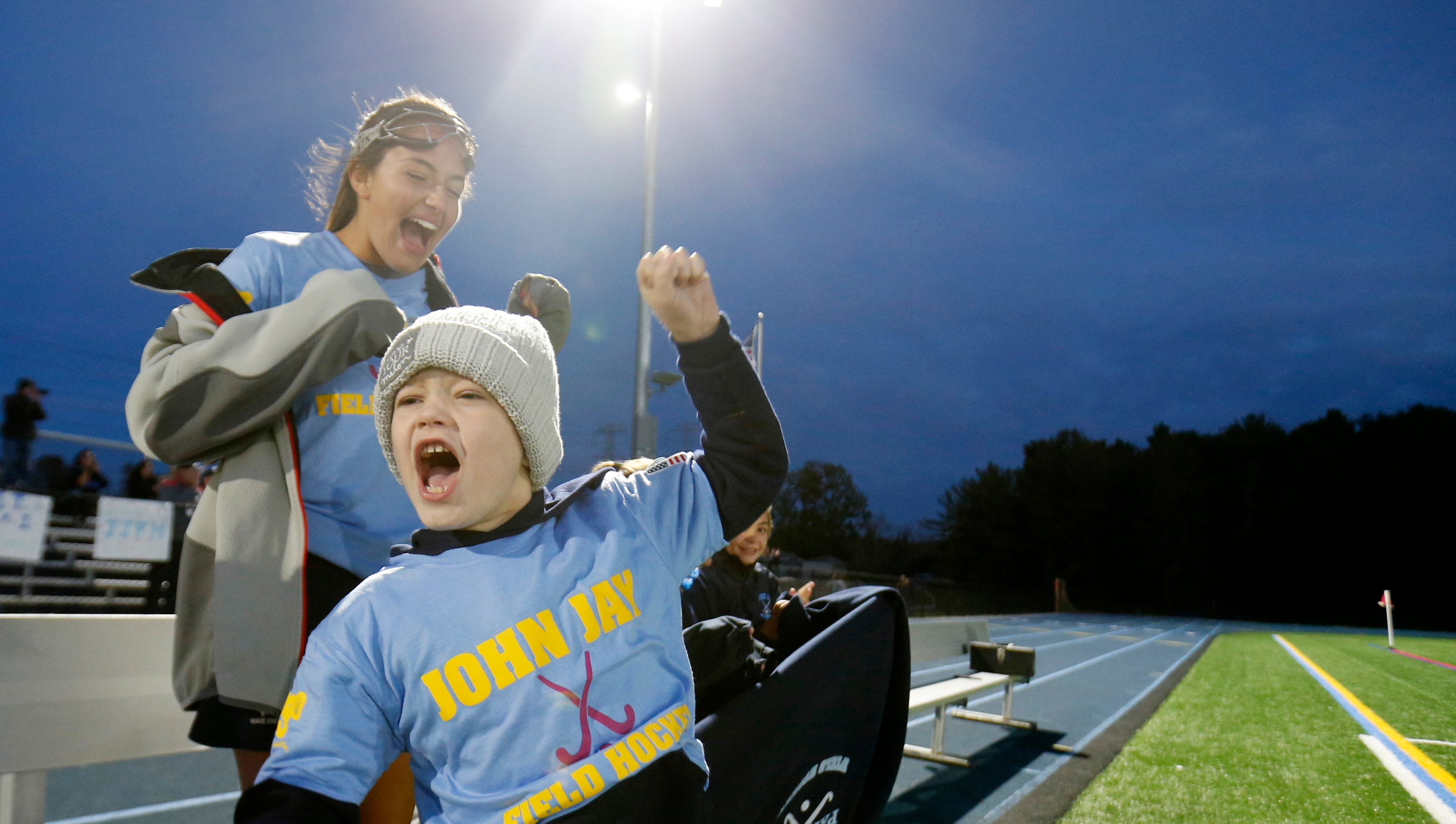 Liam Craane cheers with John Jay field hockey player Adriana Olivia during to the Tuesday's game versus Arlington on October 16, 2018. John Jay's field hockey team adopted Craane as part of the Friends of Jaclyn a charity that pairs children fighting cancer with local sports teams.