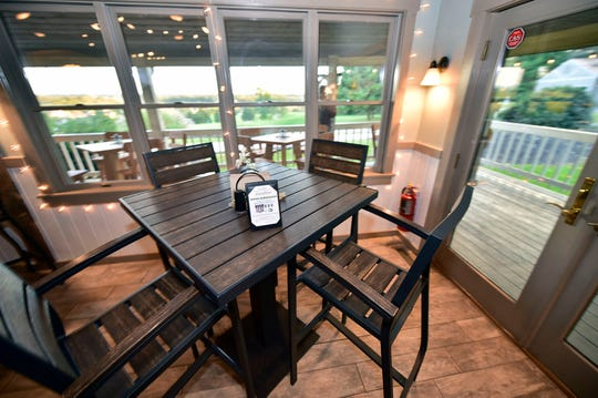 The dining room at Fireside Pub looks over the golf course at Greencastle Golf Club.