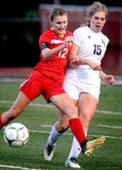 Susquehannock's Ashlynn Weger protects the ball with  Dallastown's Maddie McDermott defending during quarterfinal soccer action at Northeastern High School Tuesday, October 16, 2018. Bill Kalina photo