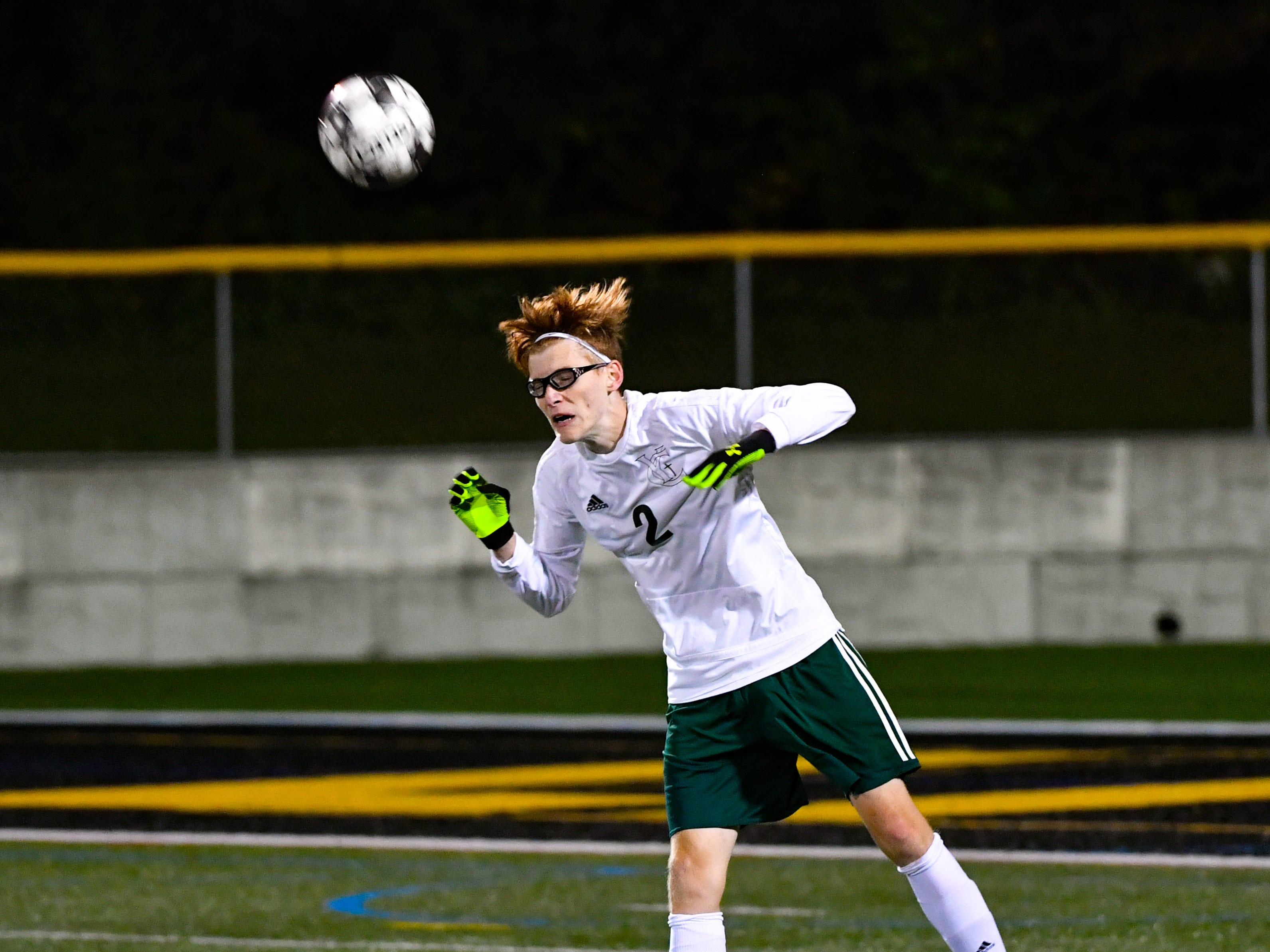 Phillip Jahn (2) sends a header up field during the boys soccer game between South Western and York Catholic, October 16, 2018. The Mustangs beat the Irish 2-1.