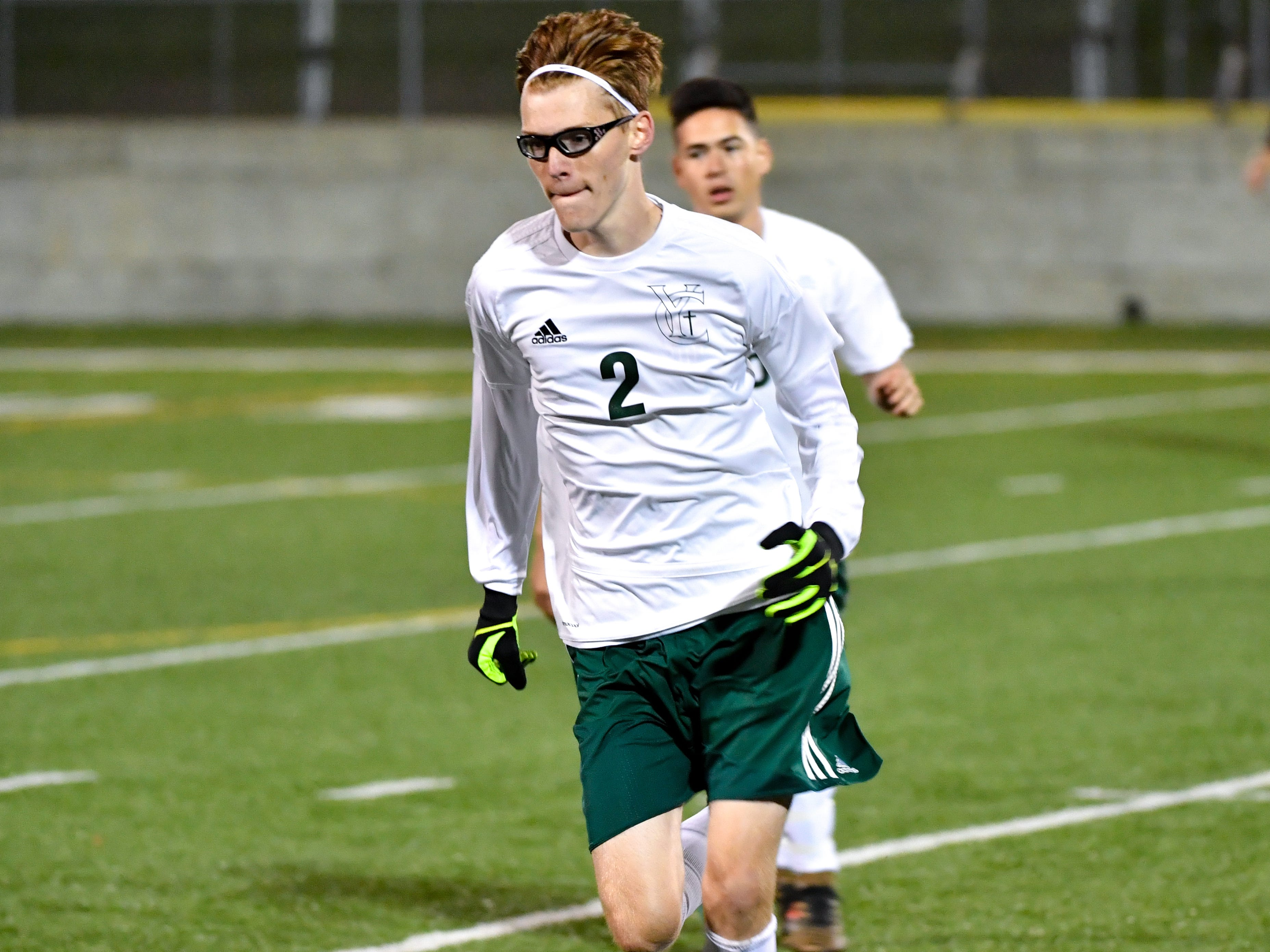 Phillip Jahn (2) runs the ball to the sideline during the boys soccer game between South Western and York Catholic, October 16, 2018. The Mustangs beat the Irish 2-1.