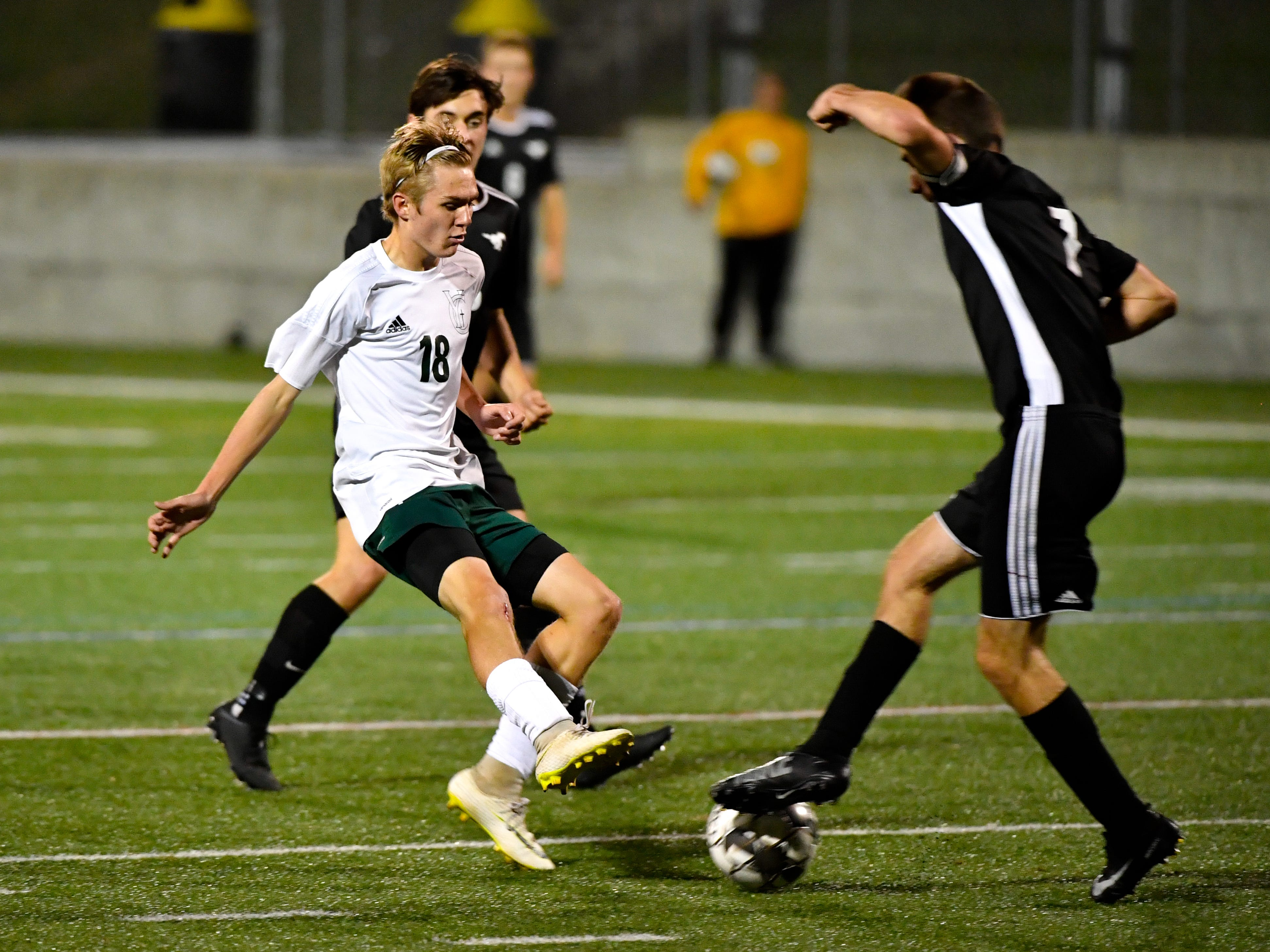 Ben Bullen (18) of York Catholic looks to steal the ball during the boys soccer game between South Western and York Catholic, October 16, 2018. The Mustangs beat the Irish 2-1.