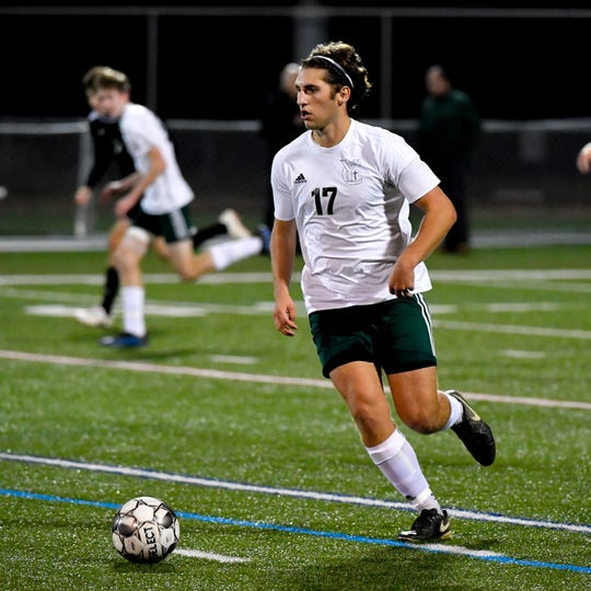 Nick Demarco (17) keeps control of the ball during the boys soccer game between South Western and York Catholic, October 16, 2018. The Mustangs beat the Irish 2-1.